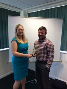 Tracy Davis presenting Mark Wrigley with the Team Member of the Month Trophy.